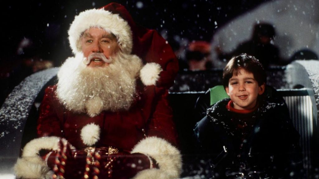 Tim Alan's Santa Claus with Charlie in Santa's sleigh